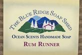 Wrapped bar of Rum Runner Goat Milk Soap